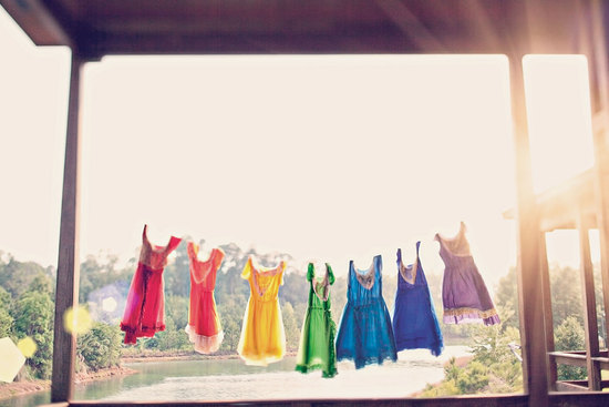 Bright rainbow bridesmaid frocks captured in the sun