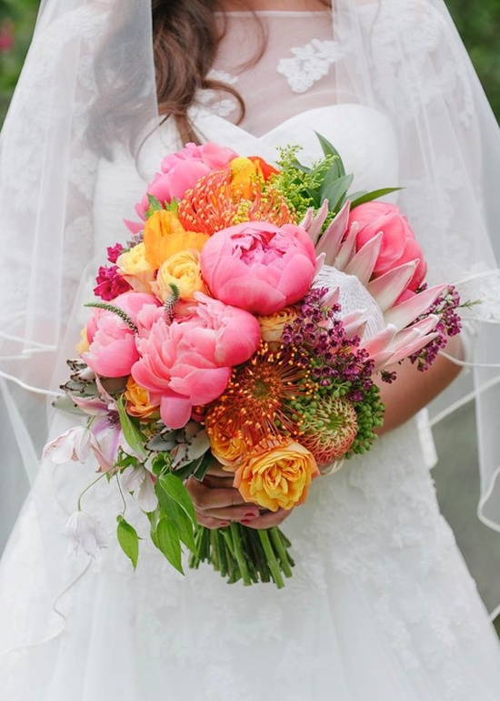 Unique bridal bouquet with bright pink peonies