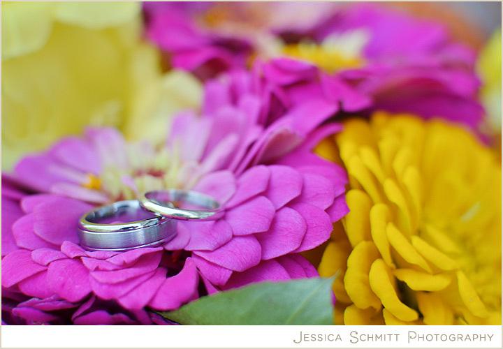 Wedding-ring-shot-atop-bright-zinnia-flowers.full