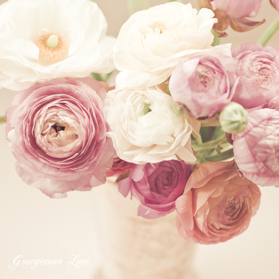 Romantic wedding centerpiece of ranunculus and david austin roses