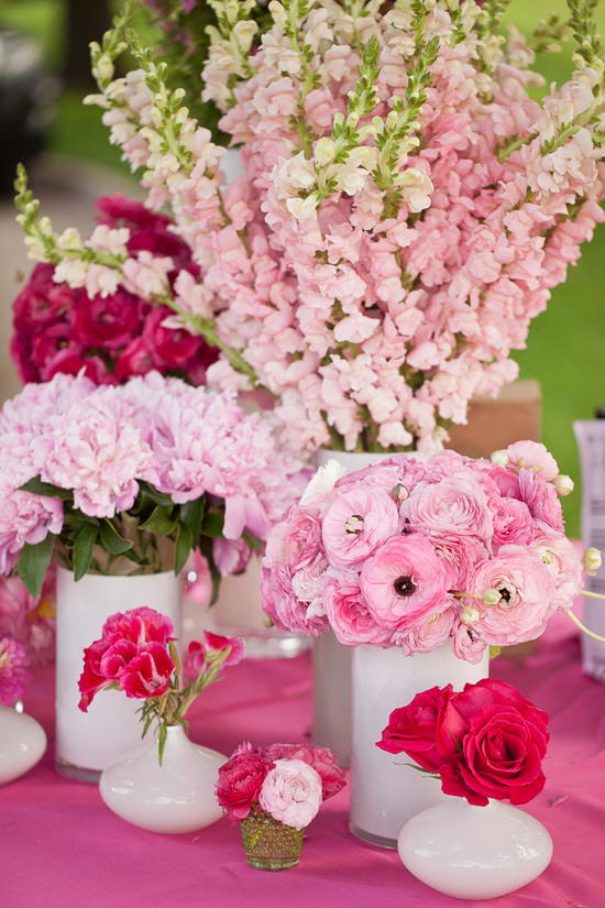 Assorted pink wedding centerpieces reception tablescape