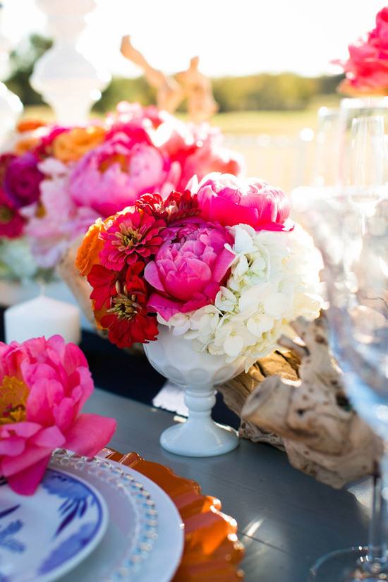 Bright beautiful wedding centerpiece with peonies and hydrangea