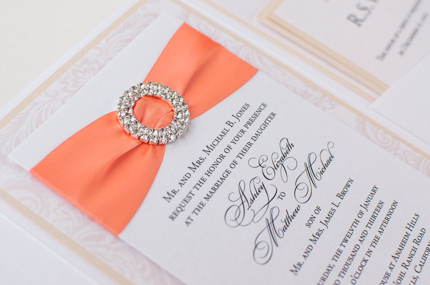 Elegant wedding invitations with nectarine and linen color scheme
