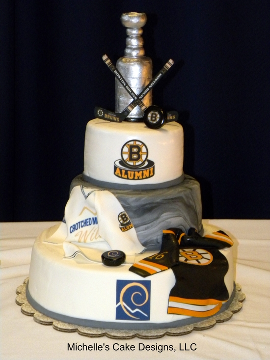 Sports themed grooms cake with stanley cup topper