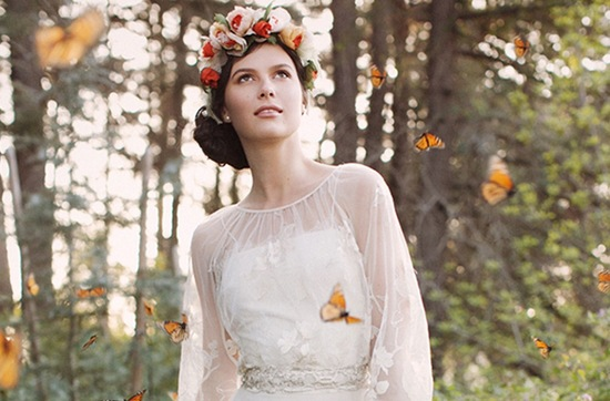 Romantic floral crown worn by vintage bohemian bride