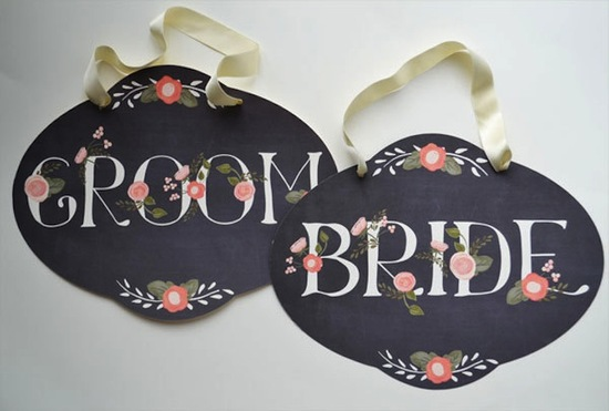 Chalkboard wedding signs with romantic florals