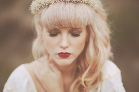 Romantic bride wears deep red lipstick brown eye shadow and thick lashes