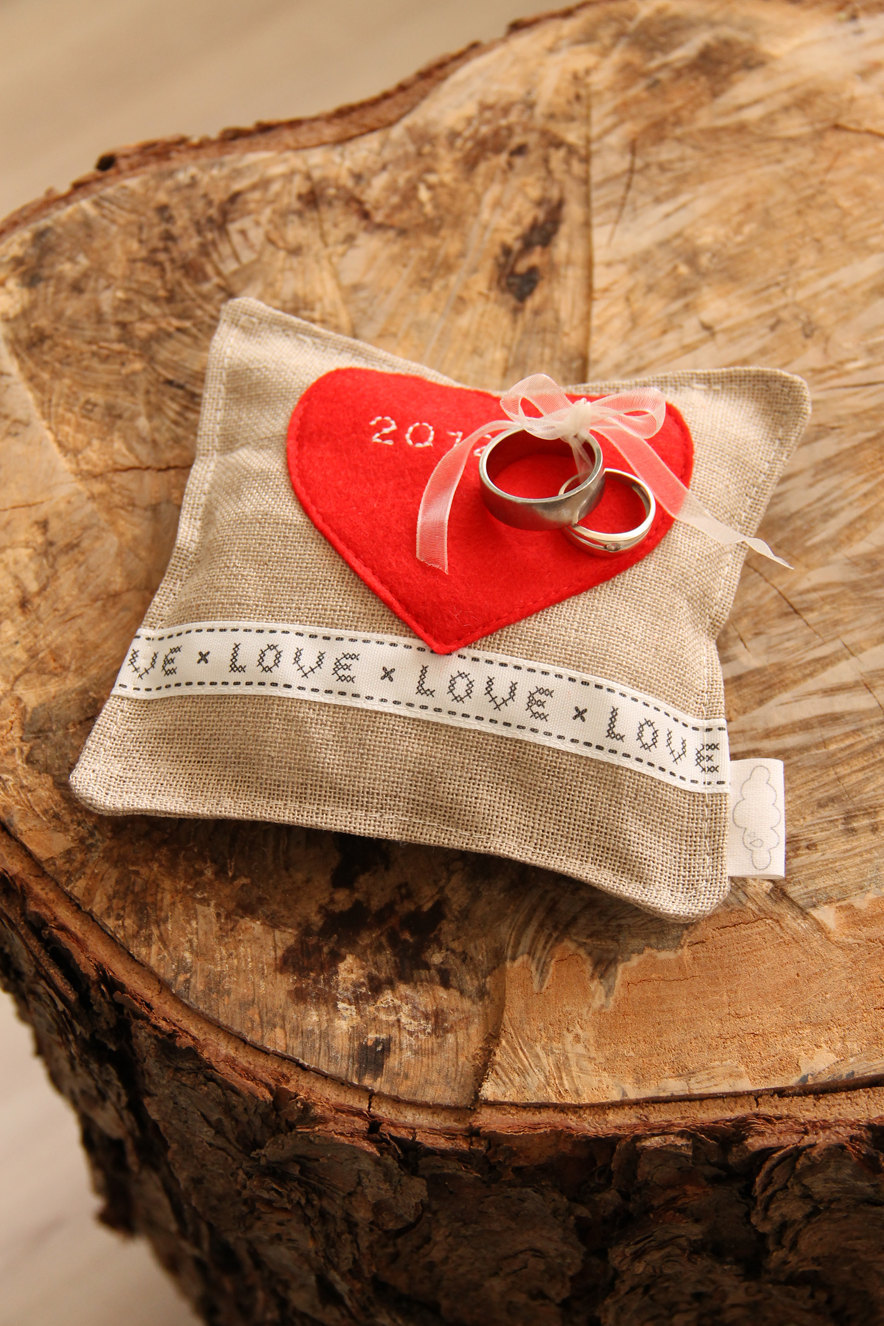 Rustic-burlap-ring-bearer-pillow-with-red-heart.full