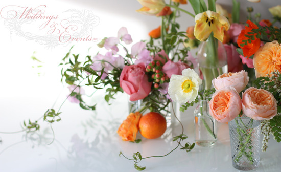 Whimsical wedding centerpieces with peach garden roses