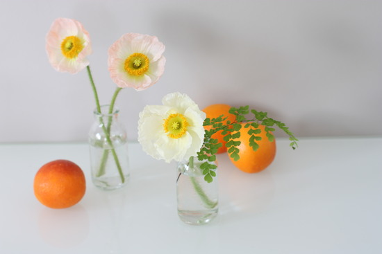 Pastel peach and orange poppy wedding centerpieces