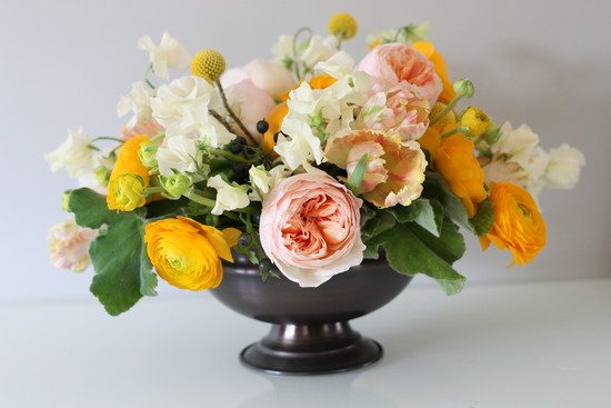 Elegant summer wedding centerpiece of ivory and peach blooms