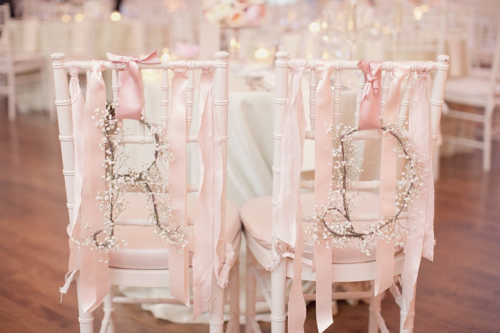 White-and-pink-wedding-chair-decor-for-the-bride-and-groom.full