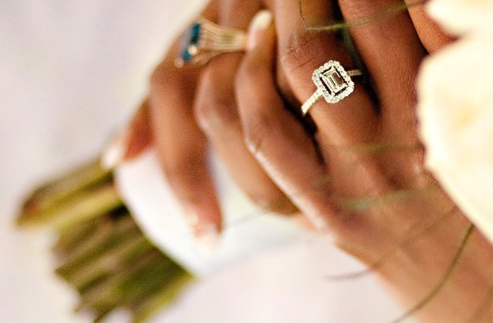 emerald cut engagement ring bride holds bridal bouquet