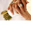 Emerald-cut-engagement-ring-bride-holds-bridal-bouquet.square