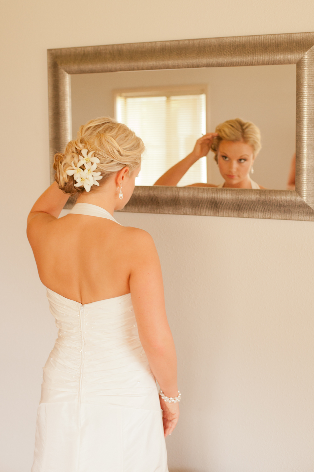 Destination-wedding-bridal-updo-finished-with-ivory-blooms.full