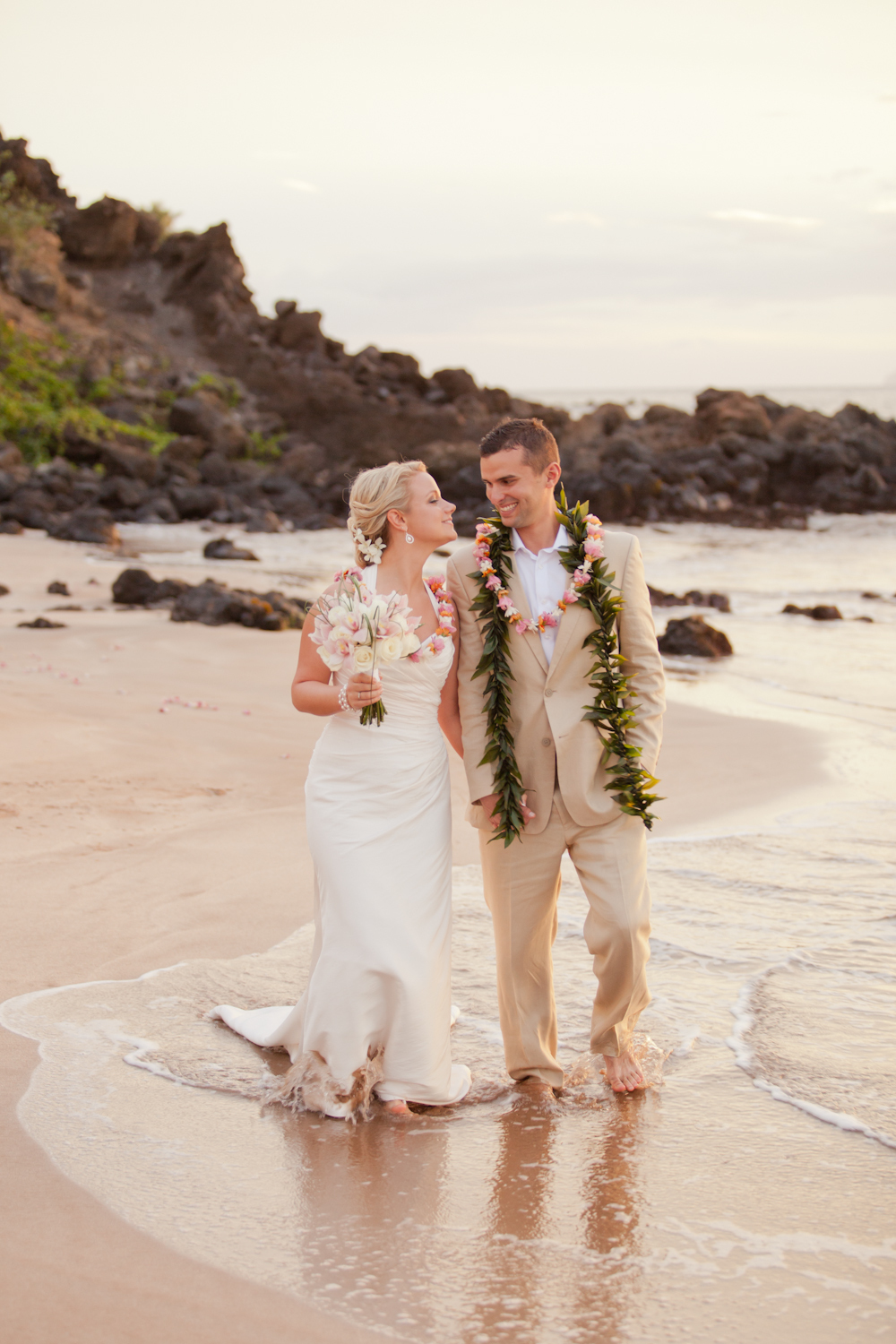Maui-bride-and-groom-walk-hand-in-hand-on-beach.full