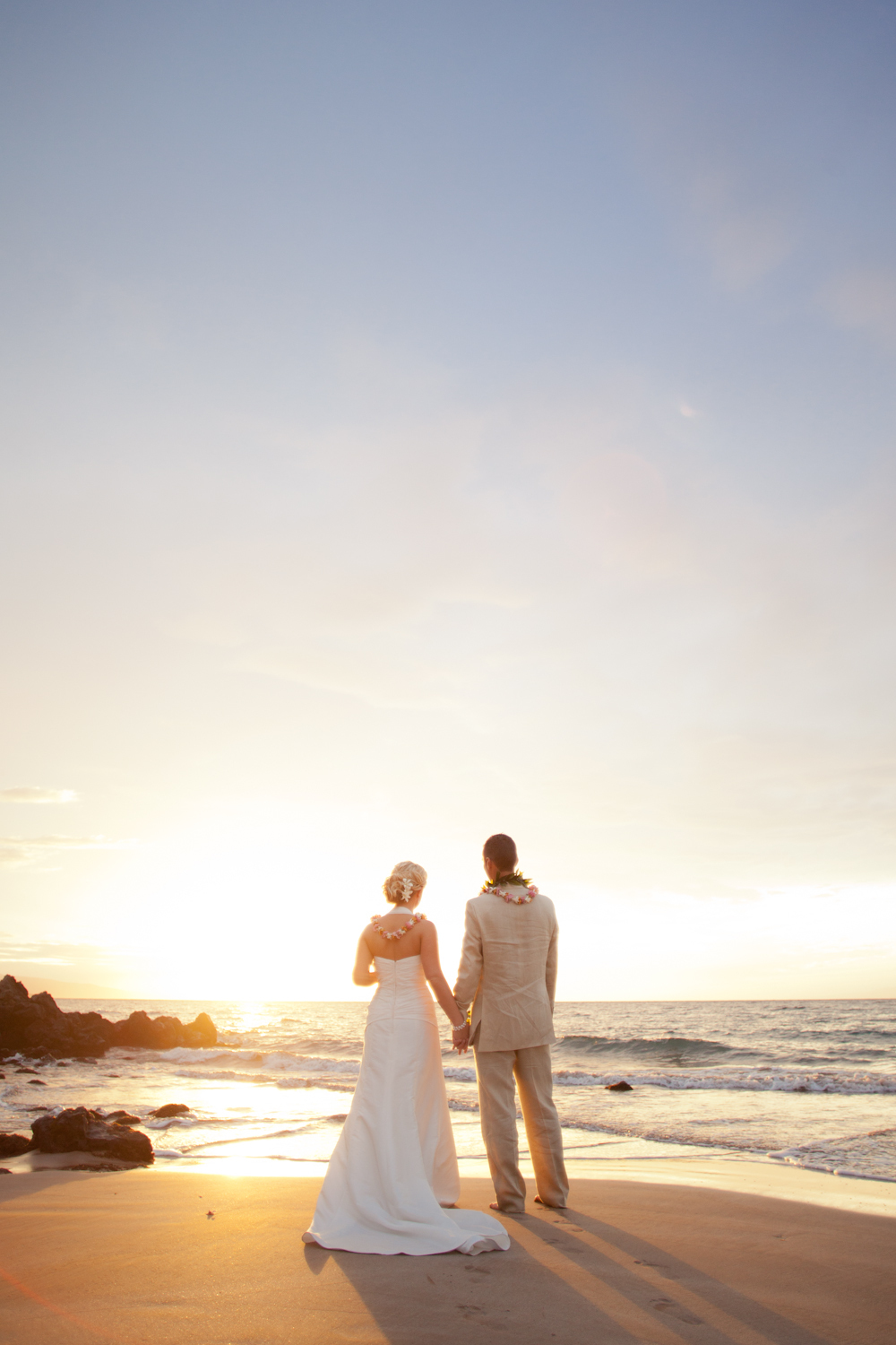 Beach-bride-and-groom-watch-the-sun-set.full