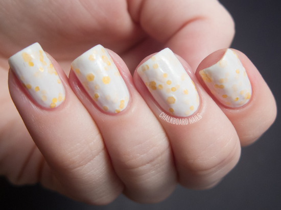 White and lemon dotted manicure