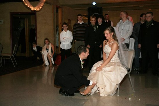 photo of bridal garter toss wedding traditions to ditch