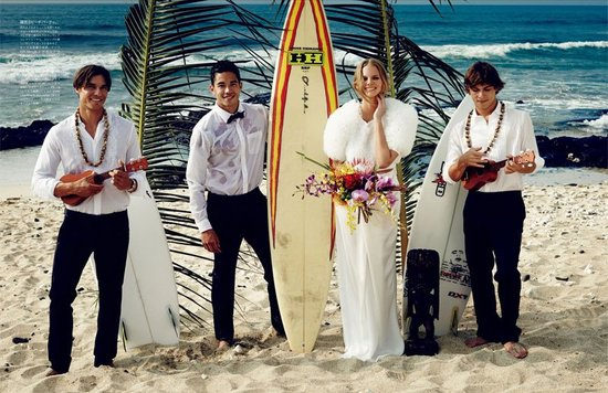 Beach bride wears fur poses with surfboard