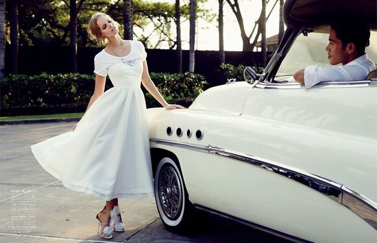 photo of Vintage bride in tea length gown floral embellished shoes