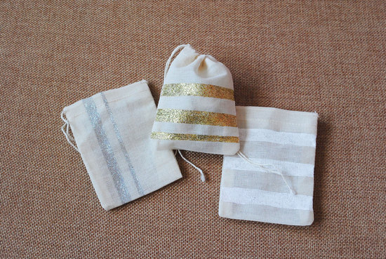 Striped muslin wedding favor bags gold silver