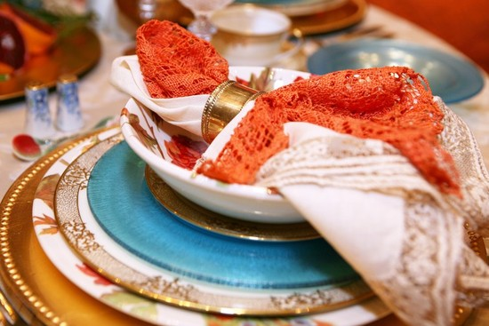 orange teal gold wedding table setting
