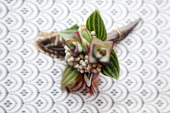 Succulent grooms boutonniere with feathers