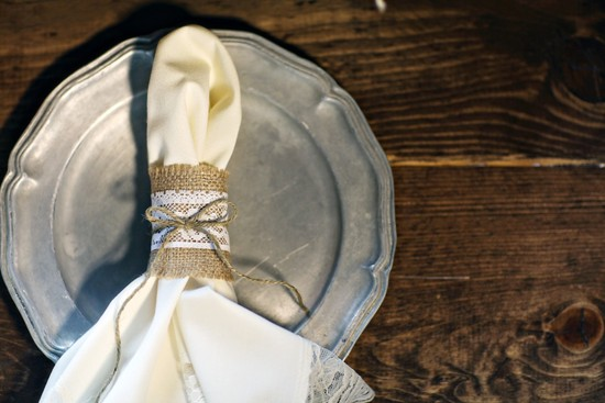 photo of Lace and burlap wrapped wedding napkins