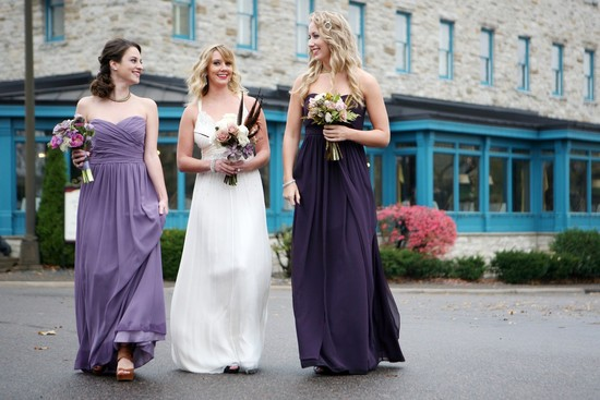 Bridesmaid in mix and match long purple gowns
