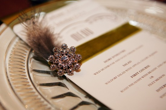 Feather and brooch embellished wedding menus