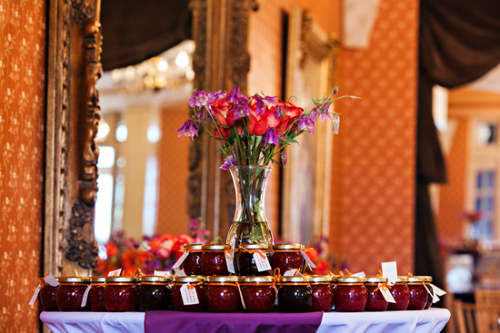Welcome table with jam wedding favors