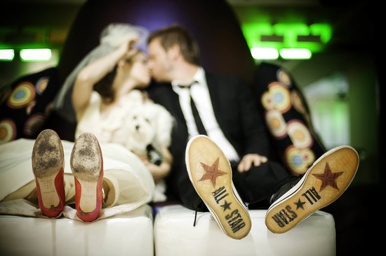 Fun wedding shoe shot bride and groom show their soles