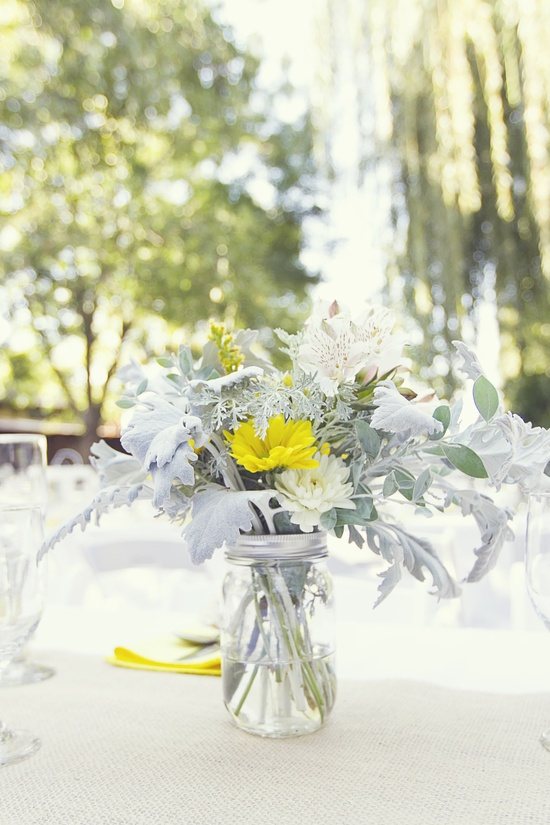 white yellow wedding flower centerpiece