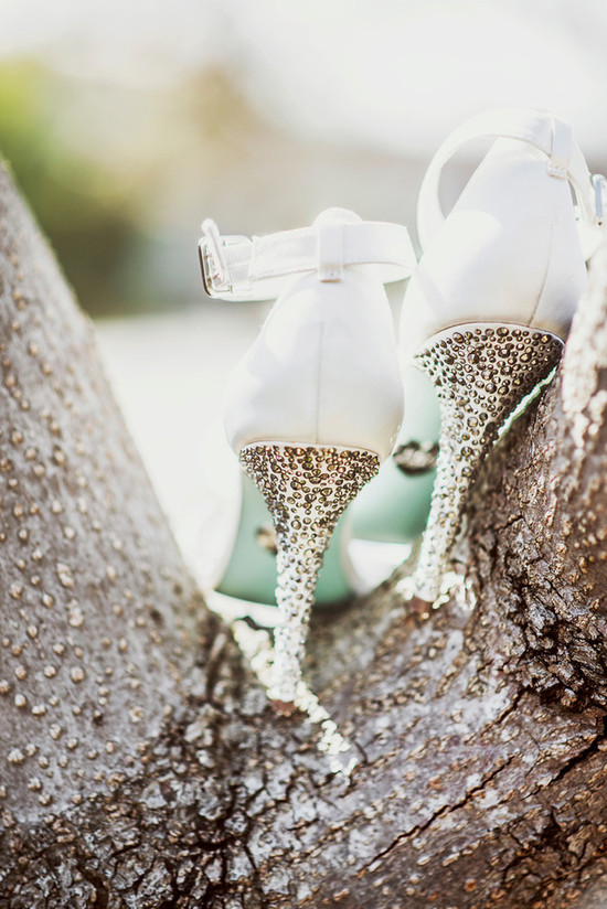 White wedding shoes with metallic studded heels