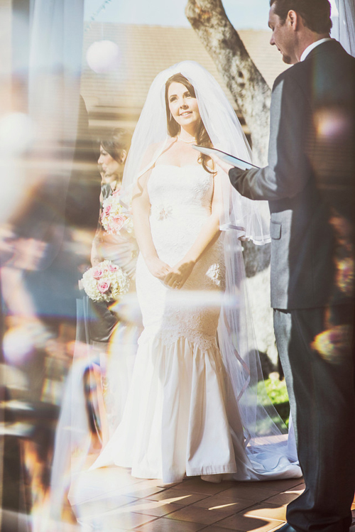 Romantic-san-diego-wedding-in-summer-bride-stands-at-altar.full