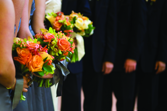bridesmaids with orange flowers