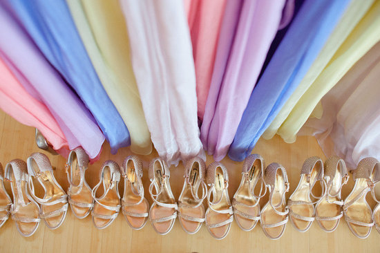 Rainbow pastel bridesmaid dresses with matching gold heels