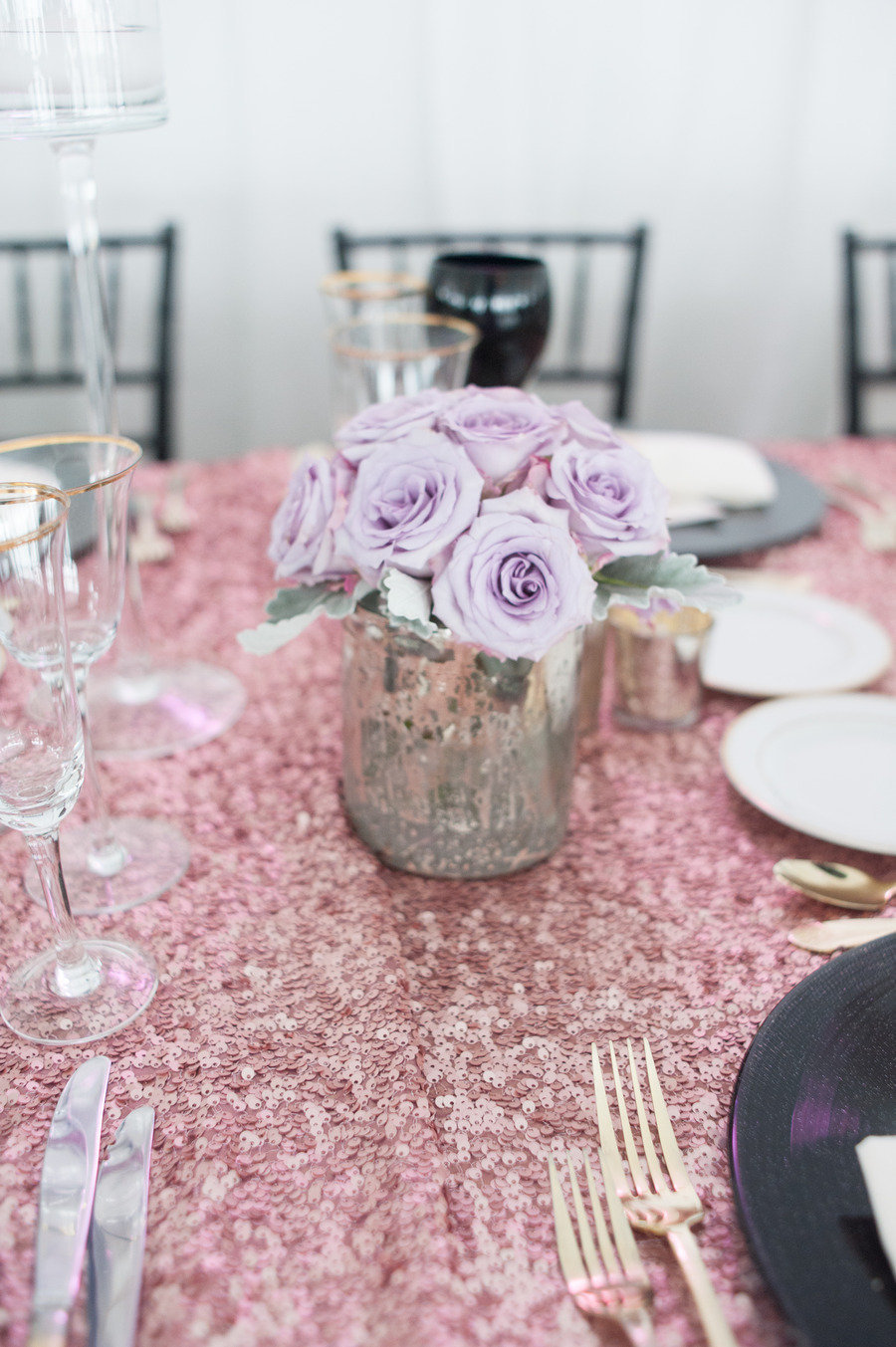 Pale-purple-roses-in-mercury-glass-vase-for-wedding-reception-centerpieces.full