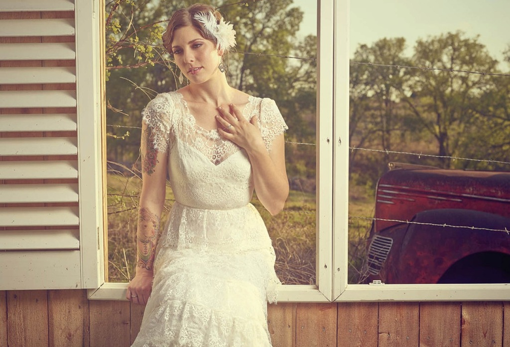 Vintage lace ruffled wedding gown with cap sleeves