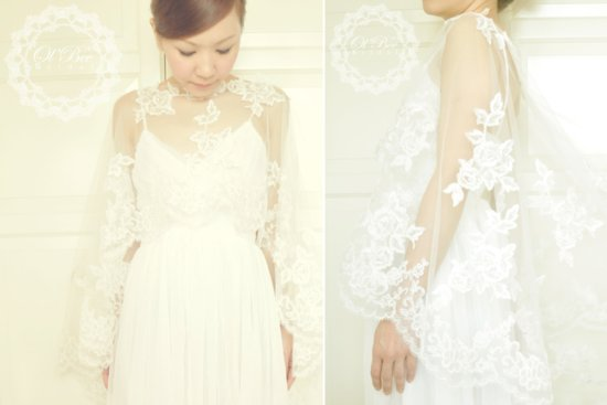 Flowing sheer lace sleeves on romantic wedding dress