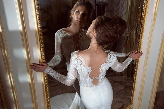 statement back white lace wedding dress with sleeves