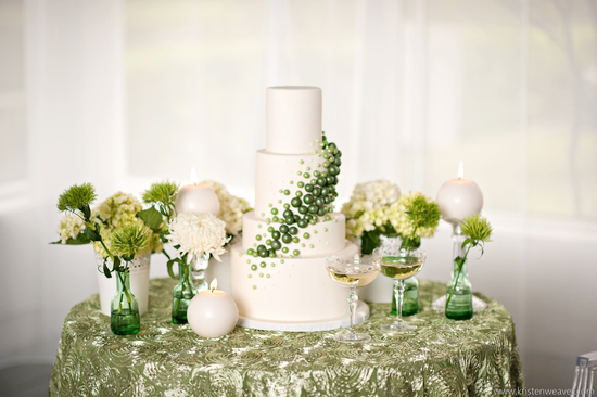White wedding cake with organic green accents
