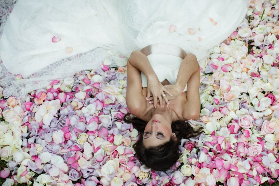Bride-lays-in-a-bed-of-romantic-roses.full