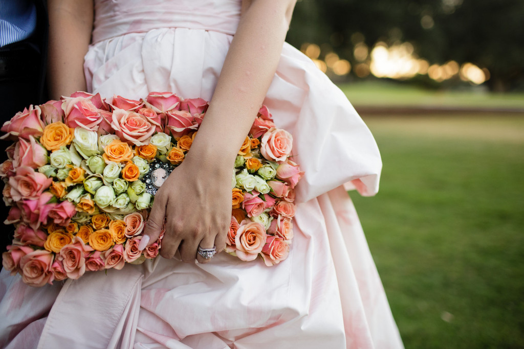 Floral covered bridal clutch
