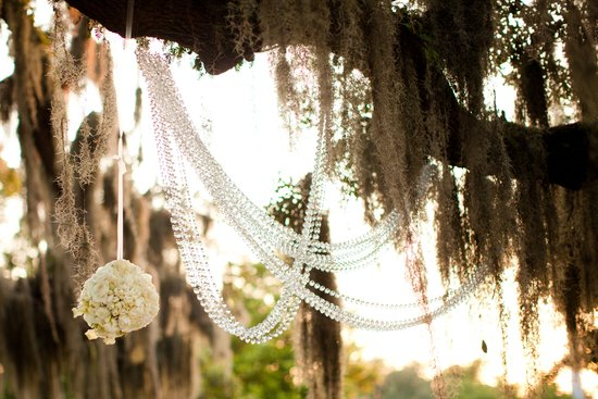 Outdoor wedding reception decor draped crystals