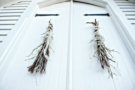 Twiggy door decor for chapel wedding ceremony