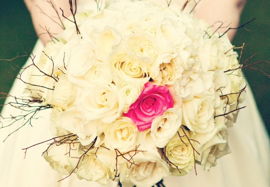 Ivory wedding bouquet with one hot pink rose