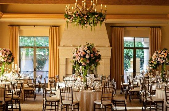 photo of pastel wedding flowers indoor wedding reception centerpieces