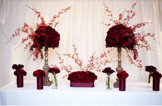 dramatic red wedding flower centerpieces topiaries